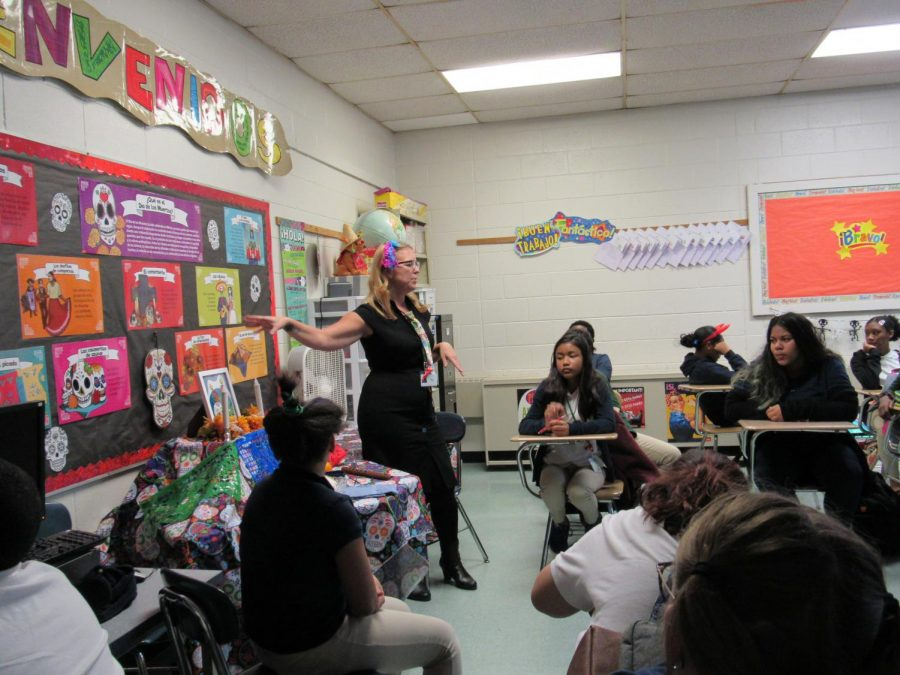 Mrs. Murphy explains different elements of Dia de los Muertos before students create their own sugar skulls.
