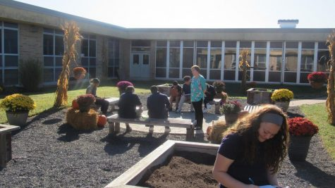 Ms. Deal and her Art 2 students in the Bernzomatic Garden for still-life practice.