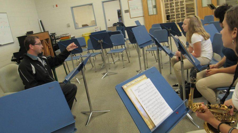 Mr. Garonzik teaches his band class.