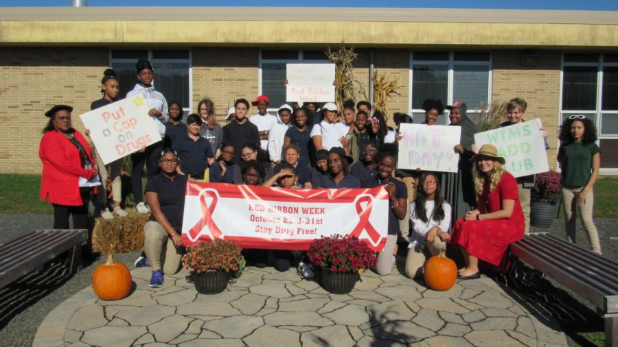 Members of SADD Club pose in the Bernzomatic Garden to celebrate their successful Red Ribbon Week.