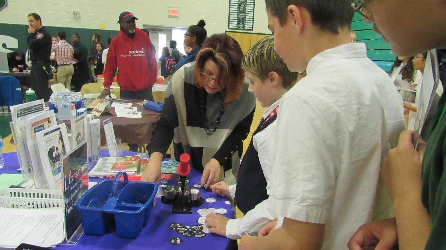 WTMS students interact with the representatives at many different tables.