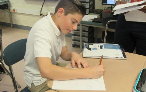 Harris working in Mr. Martin's math room. Harris credits his win to his work ethic and strong participation.
