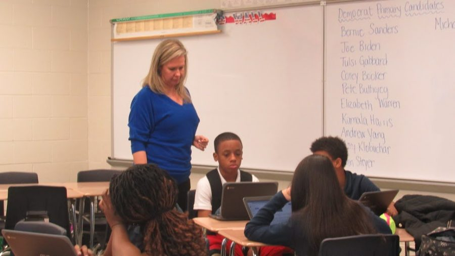 Mrs.Donohue walks around her class as her 2nd period works silently.