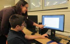 Mrs. Glatz working with one of her returning graphic design students as he begins a new project.