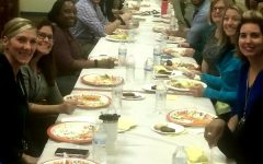 Staff members joined together at long tables to talk about family, friends, and the fun of Thanksgiving.
