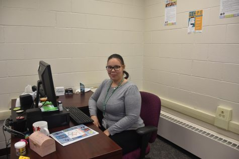 Program Coordinator Priscolla Carillo-Coleman   prepares her office and the space for the official opening.