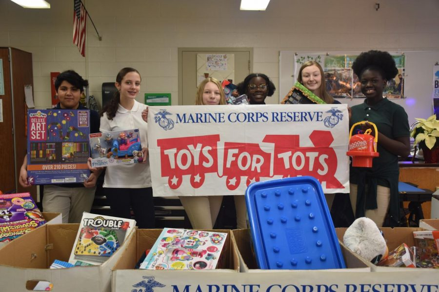 Students+from+Mr.+Cruz%27s+2nd+period+class+pose+with+toys+they+counted+%2C+sorted%2C+and+packed.