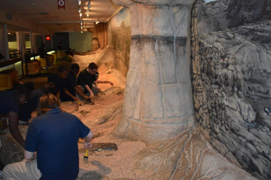 Students experienced what it was like to dig for fossils in the exhibit focused on dinosaurs and Pangea.