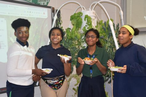 Eighth grade students enjoy their salads after their first harvest.