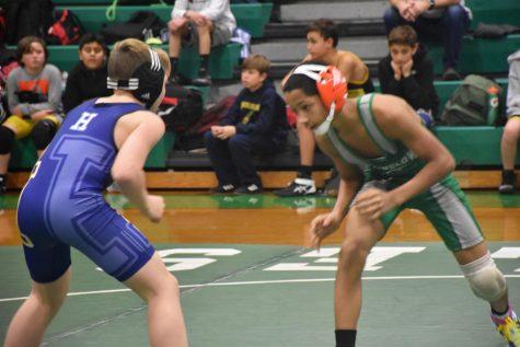 Winslow wrestler facing off against Hammonton earlier in the season.