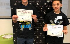 Giovanni Vera (left) pictured with 7th grader Steven Harvey after winning fourth in a regional coding competition held at NJIT.