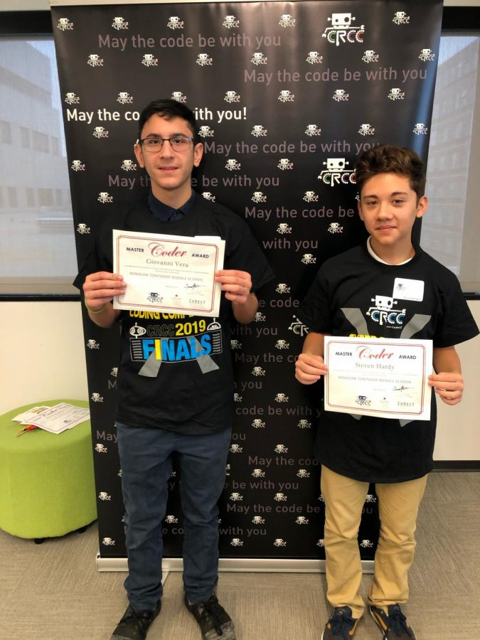 Giovanni+Vera+%28left%29+pictured+with+7th+grader+Steven+Harvey+after+winning+fourth+in+a+regional+coding+competition+held+at+NJIT.