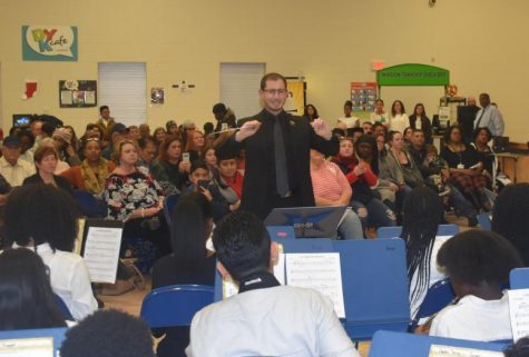 Mr. Garonzik directing the band during the 2019 Winter Concert. Although it will look different, students will still be presenting holiday favorites through recorded performances this year.