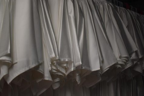 Gowns are sorted and ready to be distributed to students the final day of practice for the promotional ceremony.  Students are excited this has been moved from a virtual presentation to an in-person event.