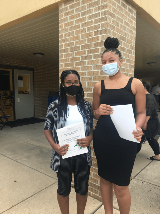 Editors Miah-Reese Govan and Talia Shumate pose together outside the cafeteria, celebrating their induction to NJHS.